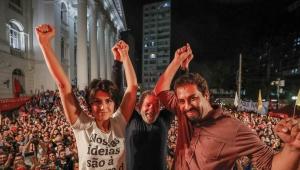 Manuela D'Ávila, Lula e Guilherme Boulos, todos pré-candidatos ao Planalto, no último dia 28 de fevereiro