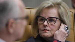 rosto da ministra rosa weber conversando com outro ministro, que está desfocado