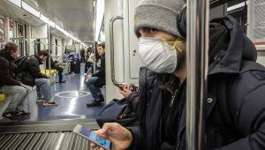 A man wearing a protective mask travels on the Milan's metro, Italy, 25 February 2020. Italian authorities say that there more than 300 confirmed cases of COVID-19 disease were registered in the country, with at least ten deaths. Precautionary measures and ordinances to tackle the spreading of the deadly virus included the closure of schools, gyms, museums and cinemas in the affected areas. (Cine, Italia) EFE/EPA/MATTEO CORNER