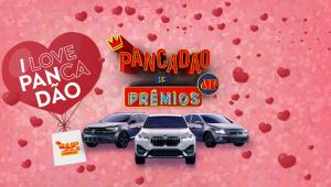 Banner mostra três carros, um coração com o nome da campanha (I Love Panxadão) e o logo Pancadão de Prêmios acima dos veículos