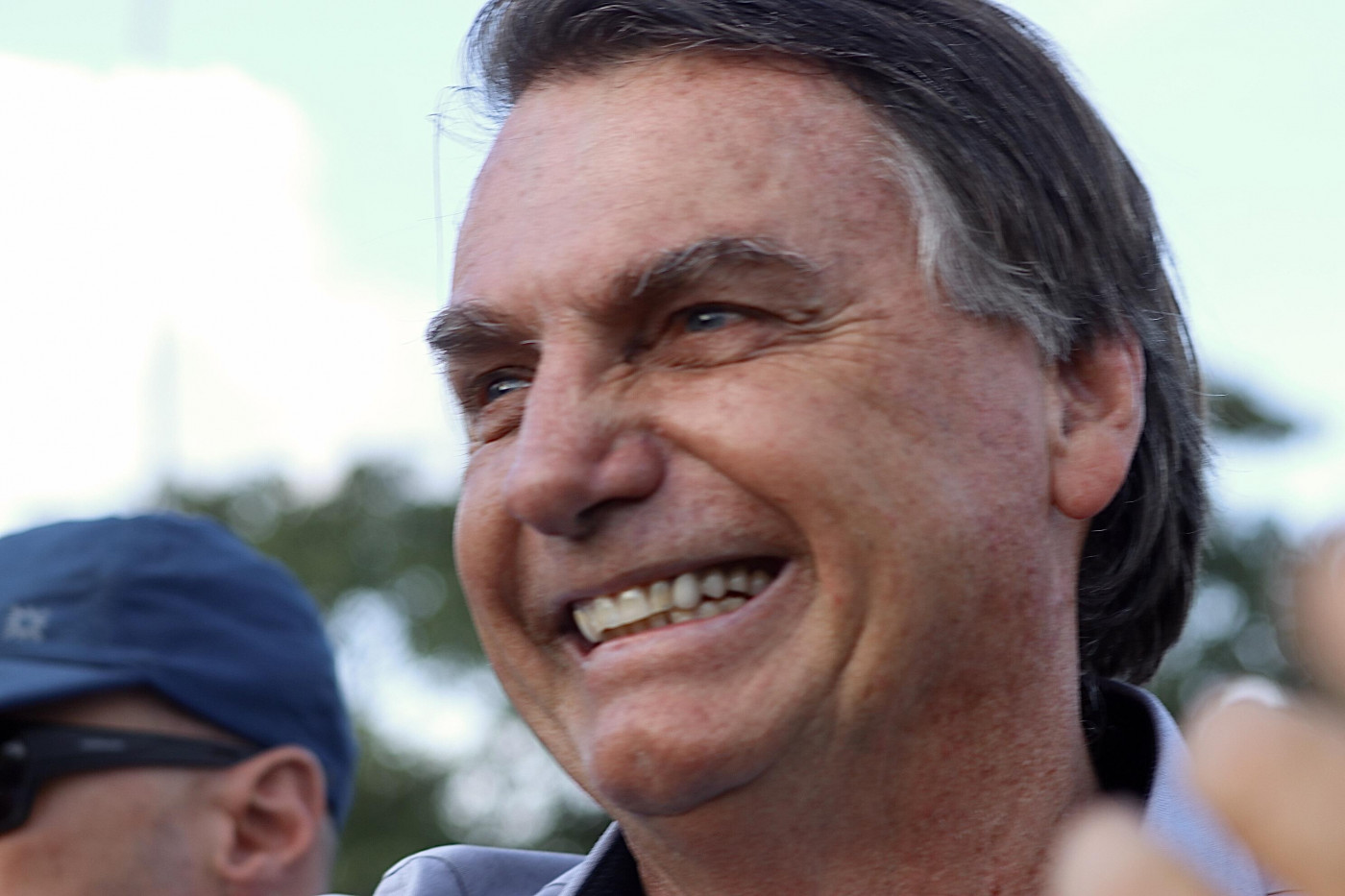 Imagem do presidente Jair Bolsonaro sorrindo