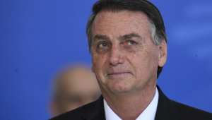 O presidente Jair Bolsonaro sorrindo