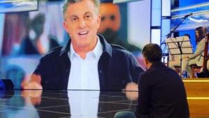 Luciano Huck assiste estreia de programa