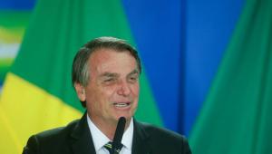 O presidente Jair Bolsonaro rindo durante discurso